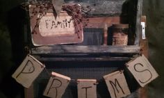 Prim grouping w/ a wooden banner