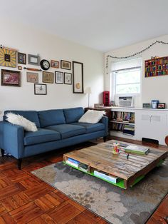 Interior, Modern Pallet Wood Floor With Blue Sofa White Cabinet With Book Shelves Wall Art Gallery Wooden Coffee Table: Excellent Flooring Designs with Awesome Pallet Wood Floor Ideas