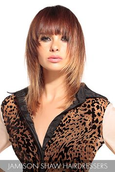 Highlight your fierce sense of style with ombré hues paired with textured layers and an intriguing curtain of bangs.