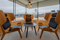 A three person meeting area has been created in this modern office in Helsinki. #Workplace #OfficeDesign