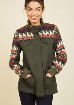 You'll love an all-day hike in this olive green jacket - so much so, you may wind up in a new locale at the end of your trek! A high neckline to keep you cozy, pockets for maps and snacks, and colorful knit sleeves characterize this anorak, and provide stylish detail to your adventure anecdotes.