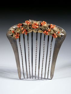 Philippines | Metal comb with hispanic decoration.  Gold leaves enriched with tiny red coral beads | 19th century