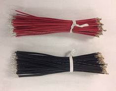 Photo of black and red bundles of UL1007 wire, cut, stripped, crimped, tin dipped and ready for shipping.