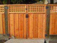 Board-on-Board Redwood Fence w/Square Lattice by Arbor Fence, Inc.