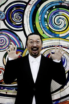 Takashi Murikami; internationally prolific contemporary Japanese artist. He works in fine arts media—such as painting and sculpture—as well as what is conventionally considered commercial media —fashion, merchandise, and animation— and is known for blurring the line between high and low arts.