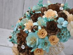 Brown & Teal wedding bouquets. The flowers are made from dyed wood ...