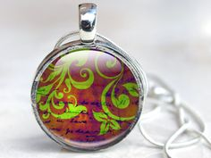 New to GlassCharmed on Etsy: Picture Necklace Glass Necklace Pendant Flowers Purple and Green swirls glass necklace Wearable Art with Flower Pattern Glass Art Necklace (12.99 GBP)