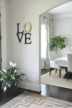 neutrals with color and pattern accents | entry way art, fiddle leaf fig, gray and polka dots