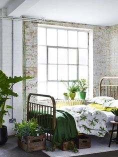 plants + exposed brick. love the green color scheme.