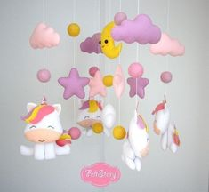 Unicorn baby mobile Nursery mobile Baby girl mobile Cot mobile Baby crib mobile Cloud mobile Baby mobile moon Pink girl mobile Stars mobile Thank you for looking! This Listing is for One Felt Unicorn nursery mobile! All these toys are made completely by hand: all the details are cut #babygirlnurserys