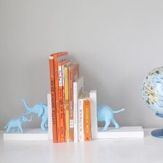 A fun and easy way to recycle toys into sweet and useful bookshelf decor for the nursery - plus the mom and baby are so cute!