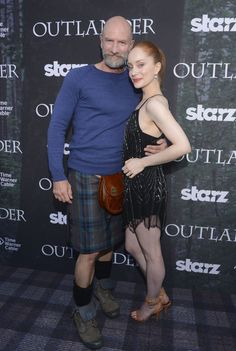 "Actor Graham McTavish and actress Lotte Verbeek attend the Starz Series ""Outlander"" Premiere - Comic-Con International 2014 at Spreckels Theatre on July 25, 2014 in San Diego, California."