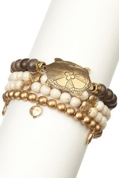 this gives me ideas for the malachite beads and Oriental fish focal    mariechavez  Gold & Grey Turtle Bracelet Set