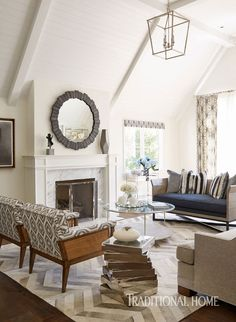 The living room is a good balance of interesting pieces and calm moments. - Photo: Victoria Pearson / Design: Michael Ostrow