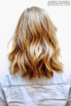 "This is one of the most requested colors & cuts all year round! A natural looking beige blonde base with bright buttery blonde highlights and a piecey long bob with minimal long layers that help create that ""lived in"" look."