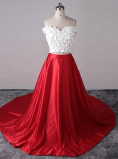 White top red satin two pieces prom dress red lipstick, bold lashes and liner, silver heels, silver jewelry