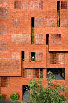 """Hooba Design Group used bricks with glass inserts to create a """"semi-transparent character"""" for the headquarters of brick manufacturer Kohan Ceram in Tehran, Iran. Dream House Interior, Home Interior Design, Interior And Exterior, Brick Facade, Brick Wall, Types Of Bricks, Solid Brick, Architectural Materials, Building Facade"""