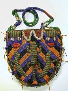 Yoruba Bag ~ Used to carry divination objects and tools, the bags are worn in public ceremonies by Ifa priestesses and used and displayed in their homes. Beads were signs of wealth and status. The beaded front lifts up to reveal a pouch on the back panel. Beaded Purses, Beaded Bags, Larp, Afrique Art, Art Perle, Textiles, African Beads, African Design, Tribal Art