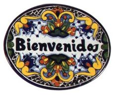 """'Bienvenidos' Talavera Plaque in Zinnia (Small) . $13.88. Hand painted. Tile welcome plaque. Dimensions: 4.5"""" x 5.5"""". Twice fired for durability. Greet visitors with this dramatic plaque featuring 'Bienvenidos' (Spanish for 'Welcome') surrounded by vibrant zinnia blossoms accented with bold blues and warm golds.   Available in 4.5"""" x 5.5"""".   Artisans create every tile entirely by hand, using a centuries-old technique that originated in Talavera de la Reina, Spain. Made ..."""