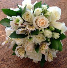 Creamed toned bridesmaid bouquet with roses, spray roses, alstromeria and emerald ruscus.