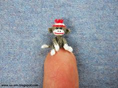 If you didn't squee when you saw this, you might be dead. Tiniest Sock Monkey Baby Sock Monkey Miniature Sock by suami