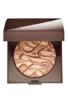 This gorgeous illuminating powder from Laura Mercier works well on fair- to medium-skinned ladies (who can pull off basically any highlight). The soft, rose-gold shimmer looks just as good in the compact as it does on your skin. And feel free to use it everywhere — even on the décolletage.Laura Mercier Face Illuminator Powder, $42, available at Sephora. #refinery29 http://www.refinery29.com/highlighter-skin-tone#slide-4