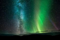 The Northern Lights, the Milky Way and several shooting stars are seen in the night sky at Ifjord in Finnmark, Norway
