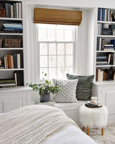 Love a cozy little window seat between two built in bookshelves!