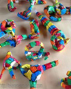 Sculpturen .... In de stijl van Niki de Saint Phalle Met papier mache; opdracht luid maak iets met 2 uitsteeksels en 1 gat