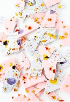 Wedding favor/dessert table color blocked chocolate bark with edible flower sprinkles - photo by Brittni Mehlhoff