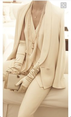 Chanel timeless classic pant suit in ivory with jacket. This outfit is professional, feminine, uptown and downtown! This Chanel suit is pure luxury! Enjoy RUSHWORLD boards, WEDDING GOWN HOUND, UNPREDICTABLE WOMEN HAUTE COUTURE and MY GOD IT'S FULL OF STARS. Follow RUSHWORLD! We're on the hunt for everything you'll love!