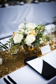glittery centerpiece | gold sequin table runner | black and gold wedding