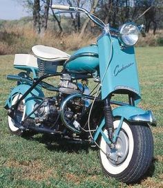 1958 Cushman Eagle Motor Scooter in Turquoise.