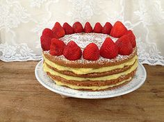 Fit For A King - chocolate cake soaked in Grand Marnier filled with homemade orange curd and topped with organic strawberries