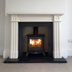 Chesneys Beaumont 5 wood burning stove with Regents limestone surround, slate hearth and slips.