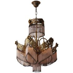Italian Brass and Glass Chandelier | From a unique collection of antique and modern chandeliers and pendants at https://www.1stdibs.com/furniture/lighting/chandeliers-pendant-lights/