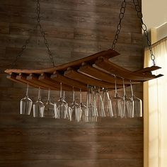 Need new stemware holder. . . this is pretty cool — Barrel Stave Hanging Stemware Rack at Wine Enthusiast - $179.95