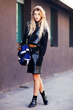 Sandra Hagelstam // Offset a sparkly daytime outfit with a brown belt and patent-leather ankle boots.