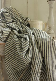 Country French Country bedding in classic ticking stripe fabric Cote Sud home decor magazine from France