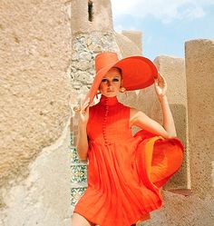 Standing next to a stone wall in Palermo, a model wears a Junior Sophisticates red chiffon pleated dress. Photographed by American fashion photographer Henry Clarke for the December 1967 issue of Vogue. via pleasure photo Vogue Vintage, Fashion Vintage, Style Année 60, Mode Style, Foto Fashion, Fashion History, Vogue Fashion, Fashion Shoot, 1960s Fashion Women