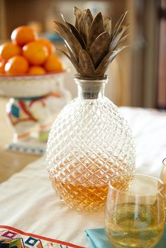 This will freshen up anyone's bar cart. It's Pier 1's brilliant, handcrafted Pineapple Decanter, rendered in the classic pineapple shape and topped dramatically with metal leaves. It's truly a work of art, as no two are exactly alike. A real showstopper when serving wine, it's also a beautiful way to show off infused vodkas, flavored rums or spring water.