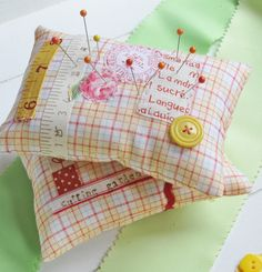 cute little pinkeeps....love that yellow and red plaid and all the little embellishments