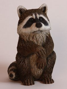 Raccoon carving done with Leah Goddard. I had so much fun carving this little guy and with Leah's permission, have taught him to many others, after they bought her roughout.. Susan L Hendrix