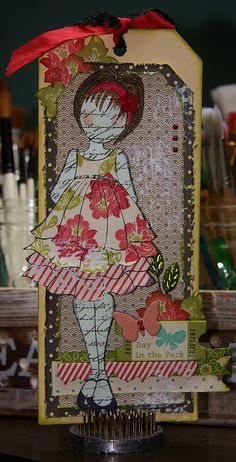 Oversized tag using Julie Nutting's Mixed Media Doll Stamp and October Afternoon Papers