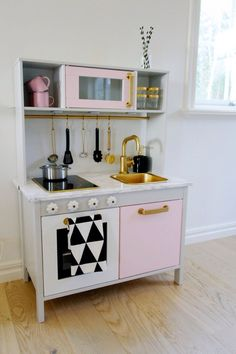 Kitchen Cute Ikea Duktig Mini Kitchen Design Come With Soft Pink And White Wooden Stained Work Table Complete With White Flower Shape Knobs And White Marble Countertop And Gold Brass Kitchen Sink And Faucet Plus Modern Cook Top And Light Brown Wooden Laminated Flooring As Well As Hanging Kitchen Utensil 20 Cool Ikea Duktig Mini Kitchen Design Collection