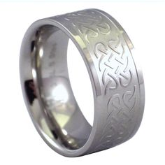 """""""WOMEN'S CELTIC KNOT RING SURGICAL STAINLESS STEEL BAND"""" Women's Celtic knot ring can be perfect as an everyday casual ring or a wedding band. This Ring is made of solid hypoallergenic silver tone 316L surgical stainless steel.  The raised Celtic knot relief pattern continues around the entire band. This ring has an 8.2mm wide comfort fit inner band, available in sizes 6.5, 7.5, 8 or 9. Be it for a special someone or The one, this ring is the perfect gift."""