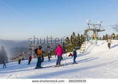 Wierchomla Mala, Poland - January 02, 2016: Family spending the weekend skiing on piste.