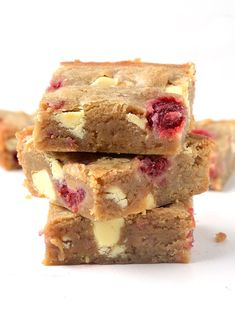 OH my word! These are the BEST blondies i've ever had! They're perfectly buttery with plenty of brown sugar and stuffed with white chocolate and raspberries. Recipe from sweetestmenu.com #blondies #chocolate #raspberries