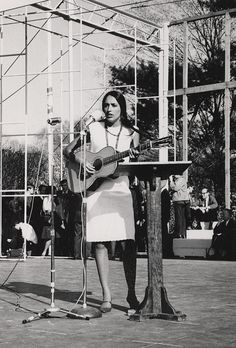 "Joan Baez singing ""I Dreamed I Saw Joe Hill Last Night,"" at a Peace March, 1965."