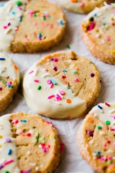 Easy make ahead funfetti slice and bake cookies dipped in white chocolate with lots of sprinkles! Recipe on sallysbakingaddiction.com